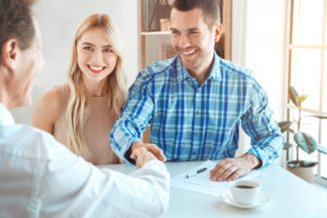 Couple Signing for Home | The Ida Terbet Group